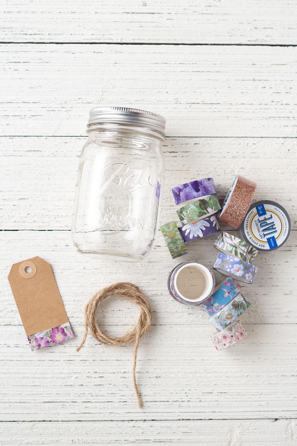 A mason jar, gift tag, twine, and washi tape.