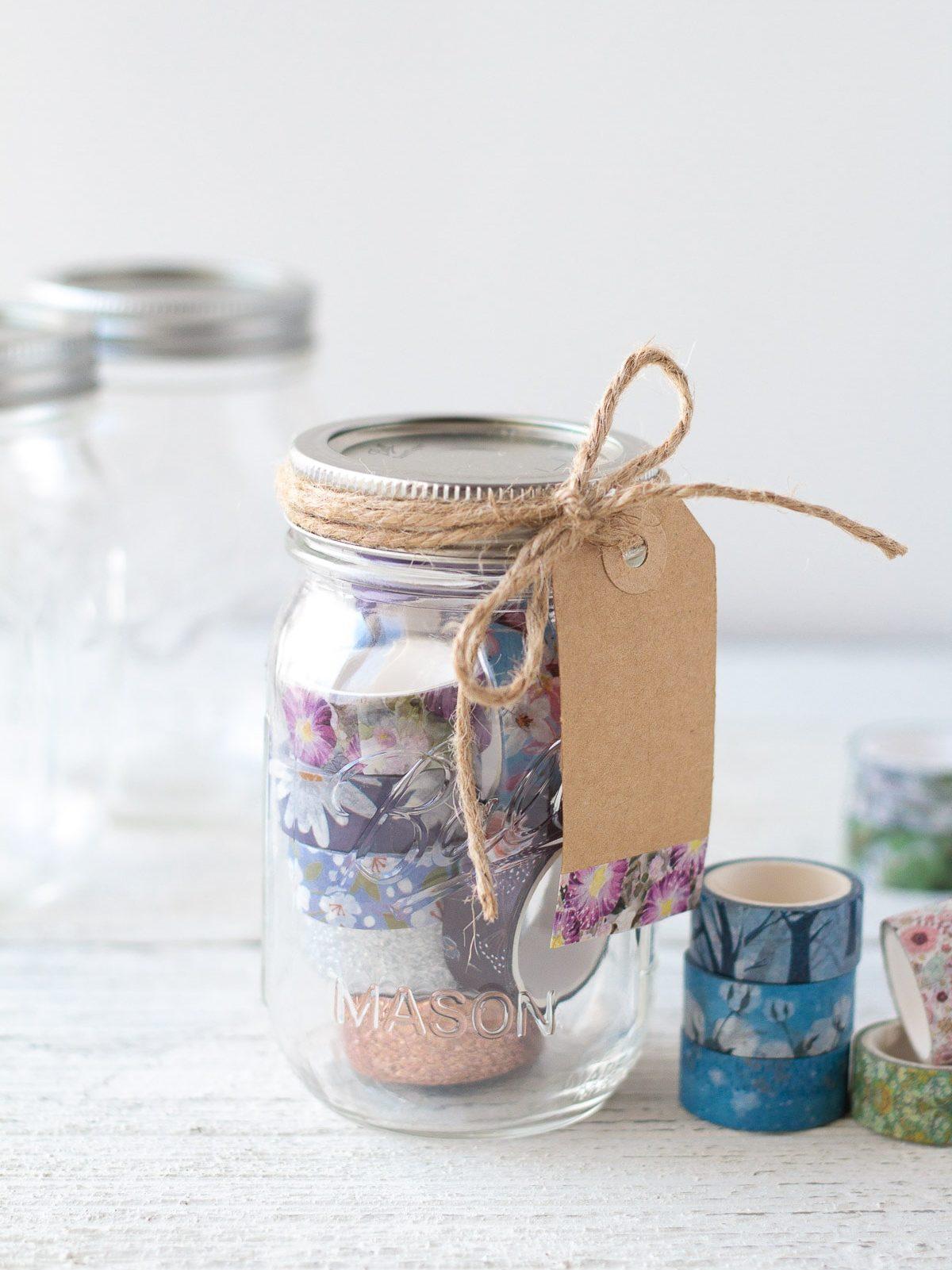 Mason jar washi tape gift idea tied with a gift tag.