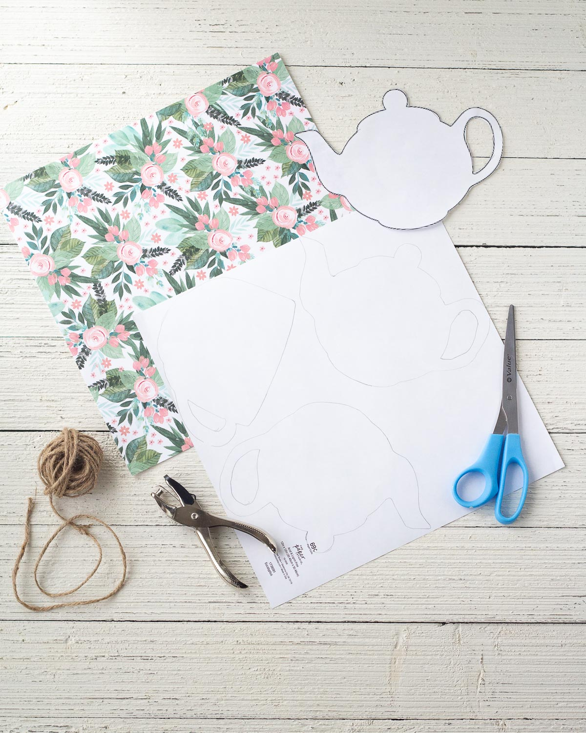 Tracing teapots and teacups onto scrapbook paper.