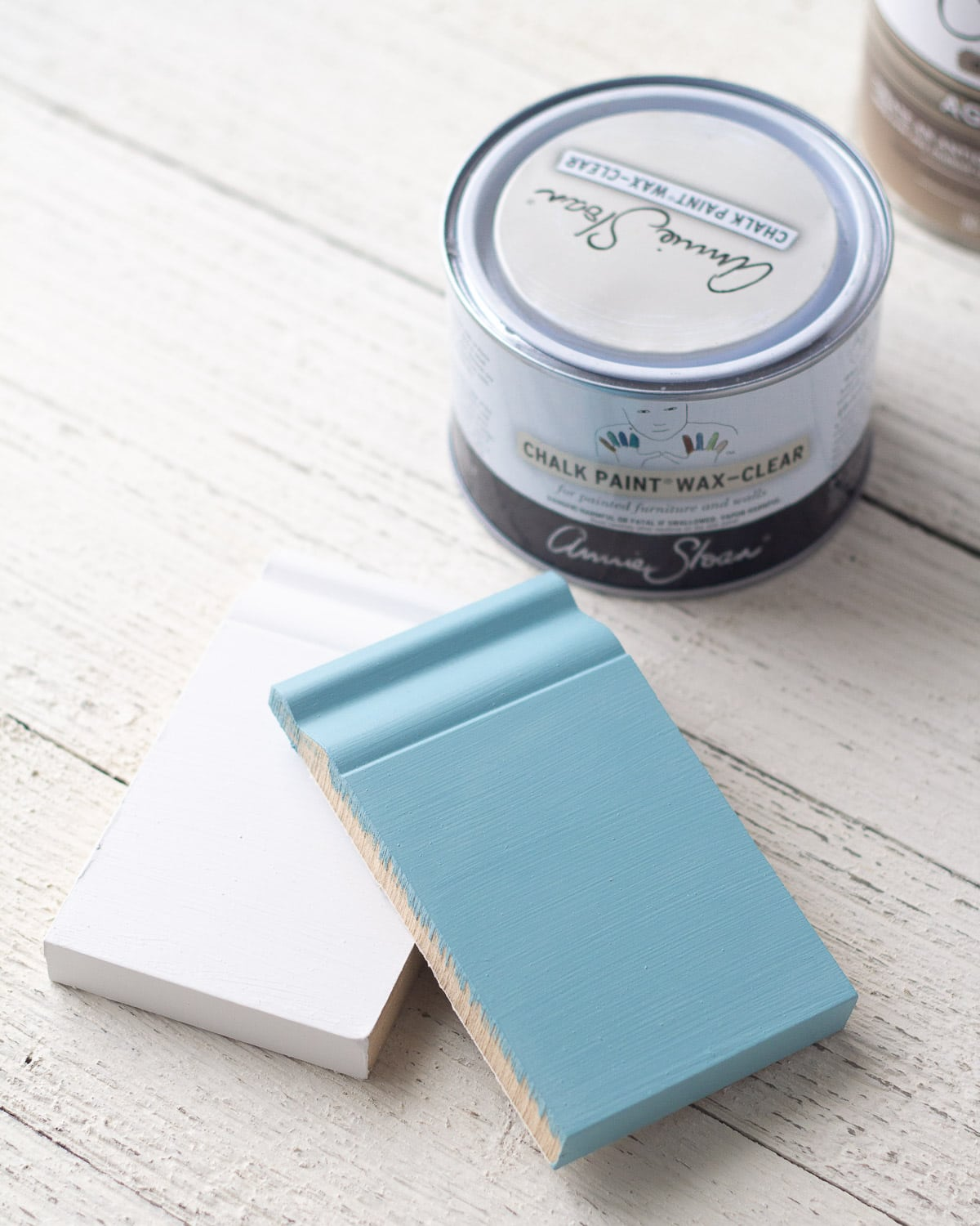 Two small samples of trim painted with white and blue chalk paint and finished with Annie Sloan Clear Wax.