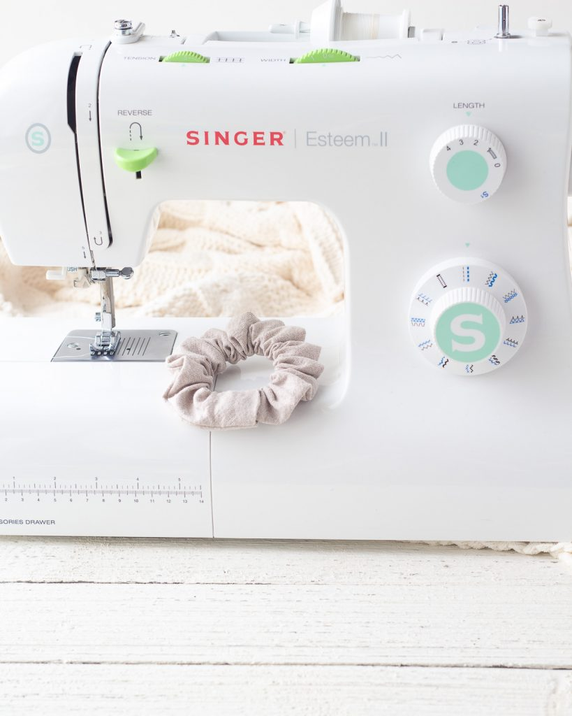 Overlapping the edges of a scrunchie to finish sewing it.