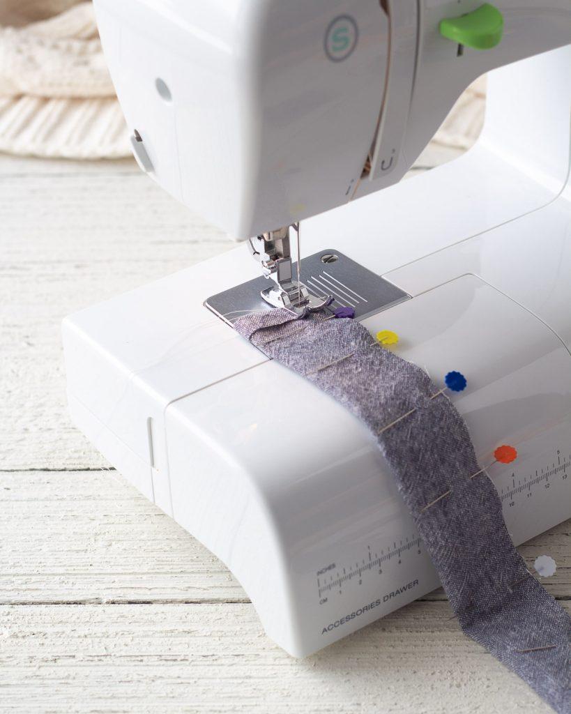 Sewing a scrunchie seam with a sewing machine.