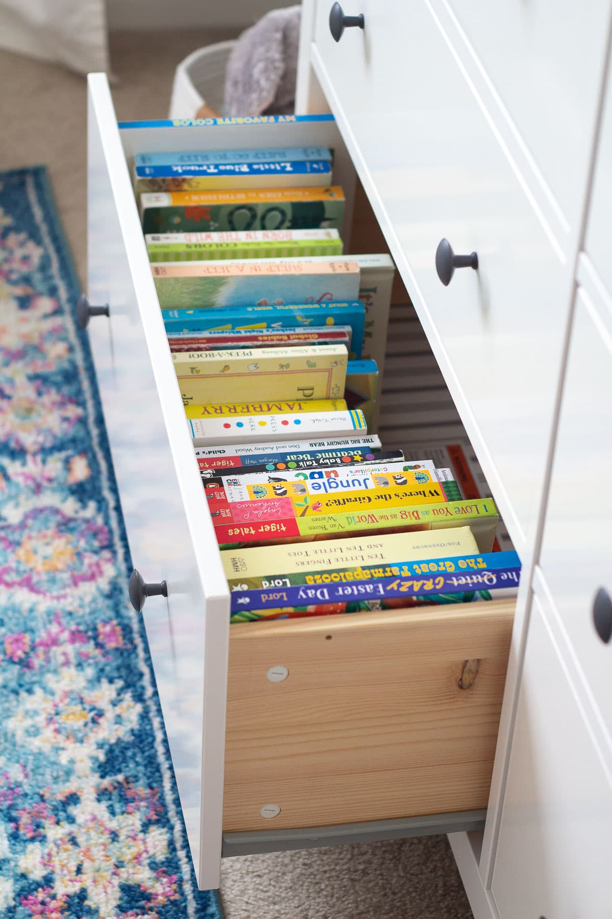 How to store kids books in the drawer of a dresser.