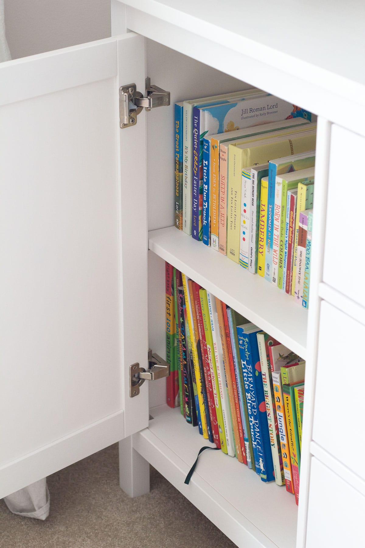 How to store kids books in a cupboard to hide them from view (board books and picture books).
