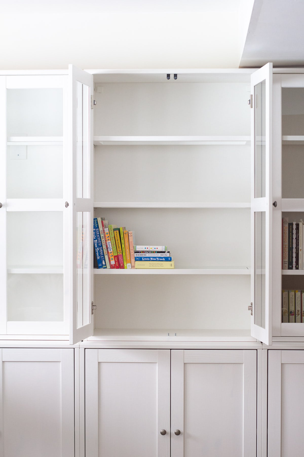 Storing board books in IKEA built-ins.