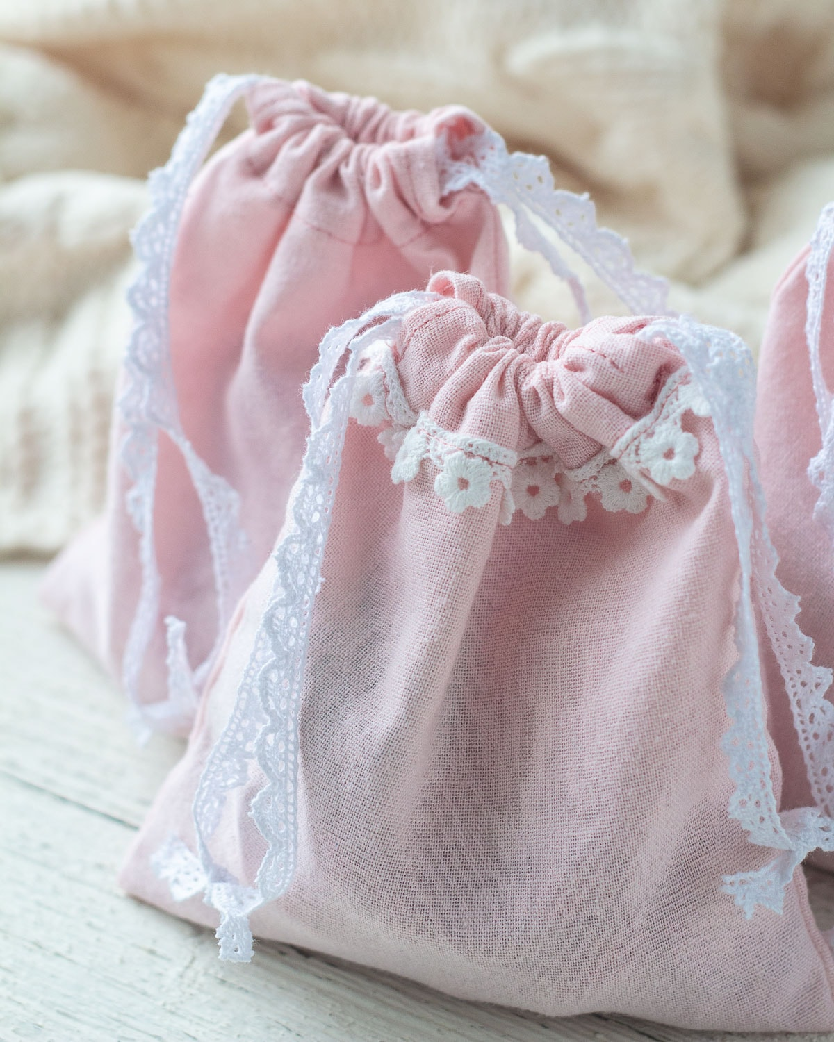 Valentine's Day DIY Gift Bags made with pink linen and lace ties.