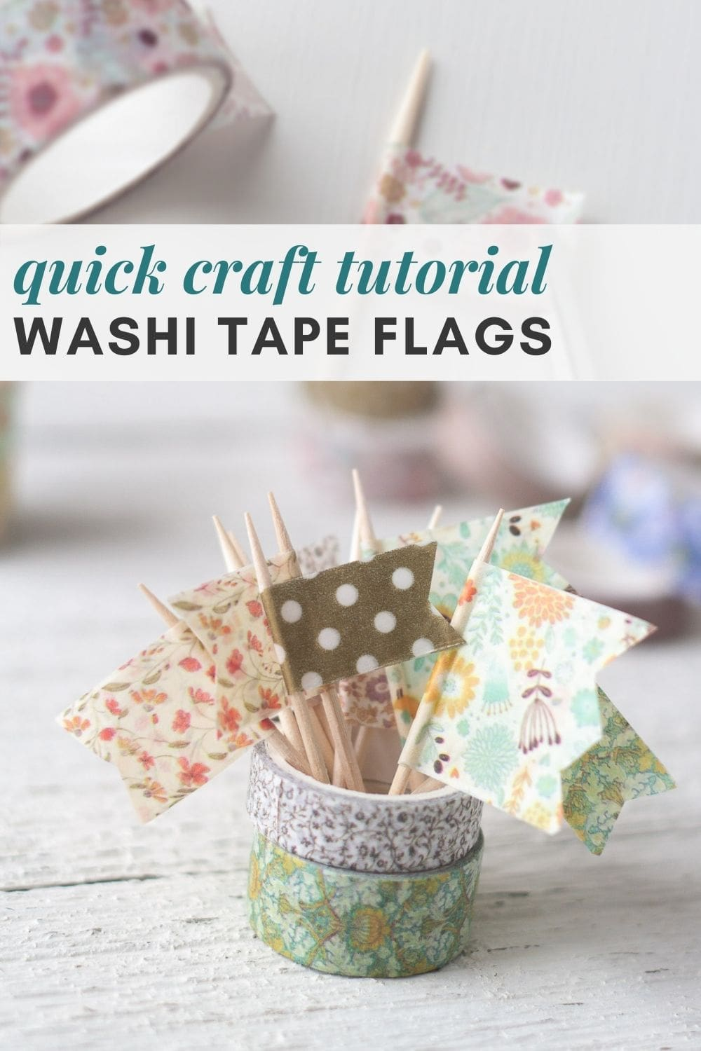 Washi tape flags made with toothpicks displayed in rolls of washi tape.