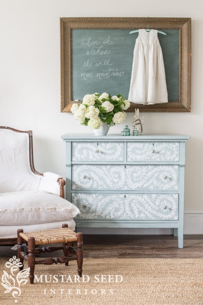 A hand painted dresser in blue and white.