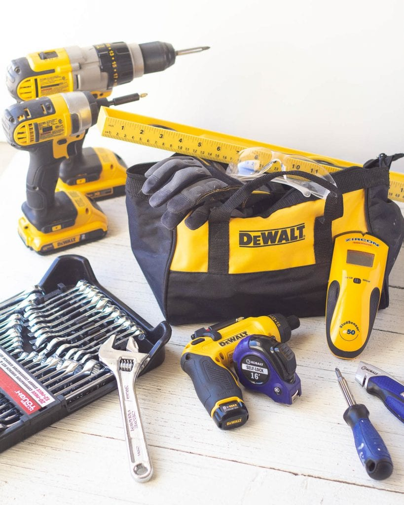 Assortment of drills and other home improvement tools.