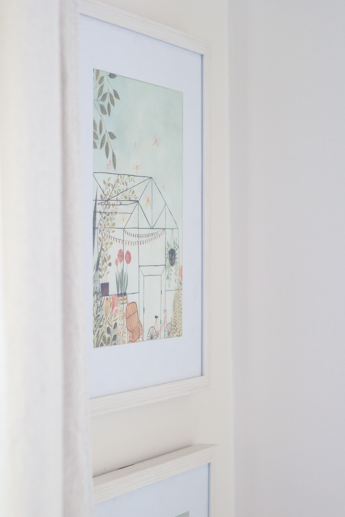 Repurposing children's books by using a page as art in a simple white frame.