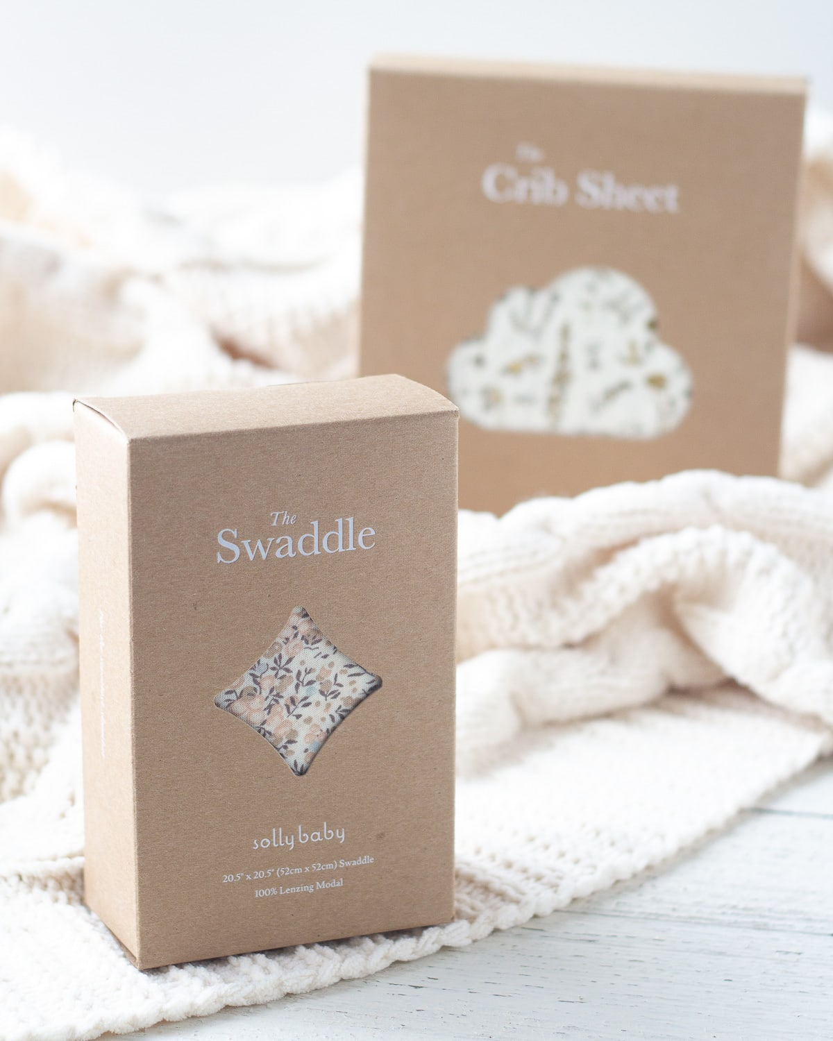 A Solly Baby Swaddle in the original box.
