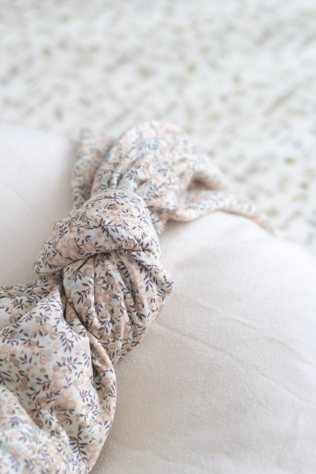 A Solly Baby Swaddle wrapped and tied in a knot.