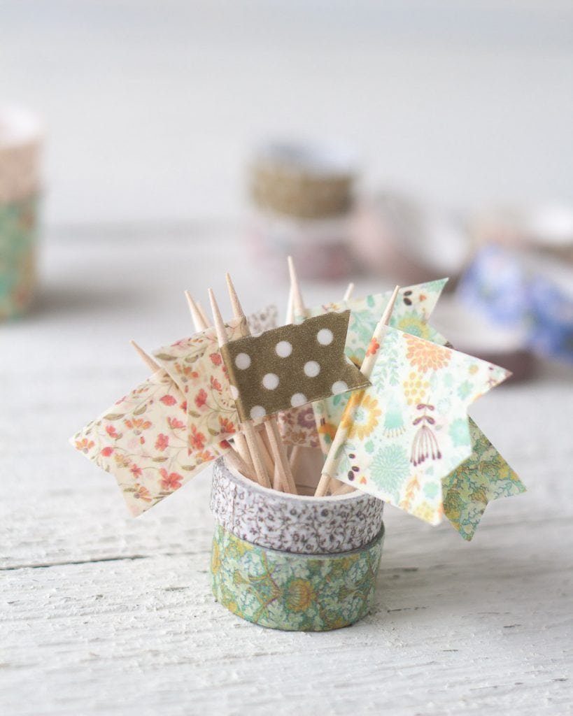 Mini flags created with washi tape and toothpicks.