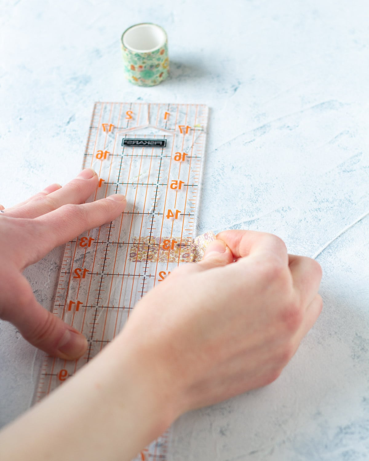 How to use a ruler to trim washi tape.