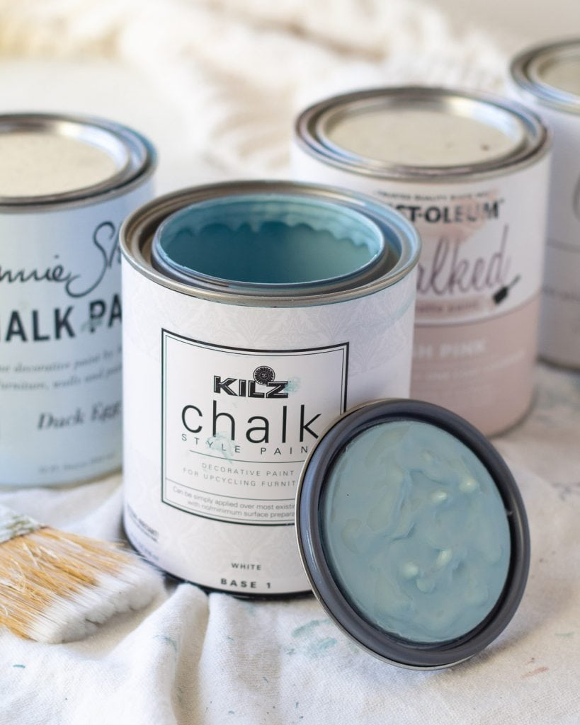 An open can of KILZ Chalk Style Paint in Blue Juniper.