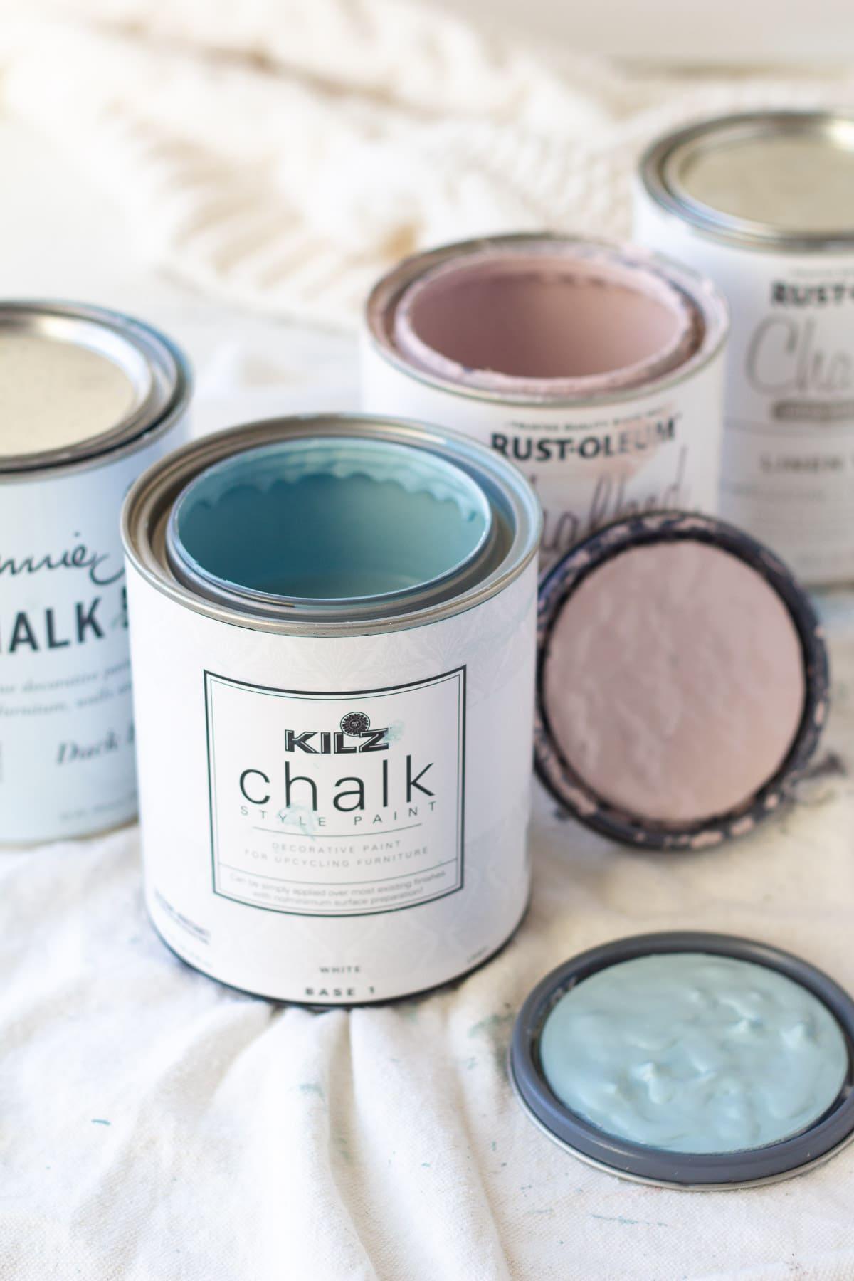 An open can of KILZ Chalk Style Paint in Blue Juniper.