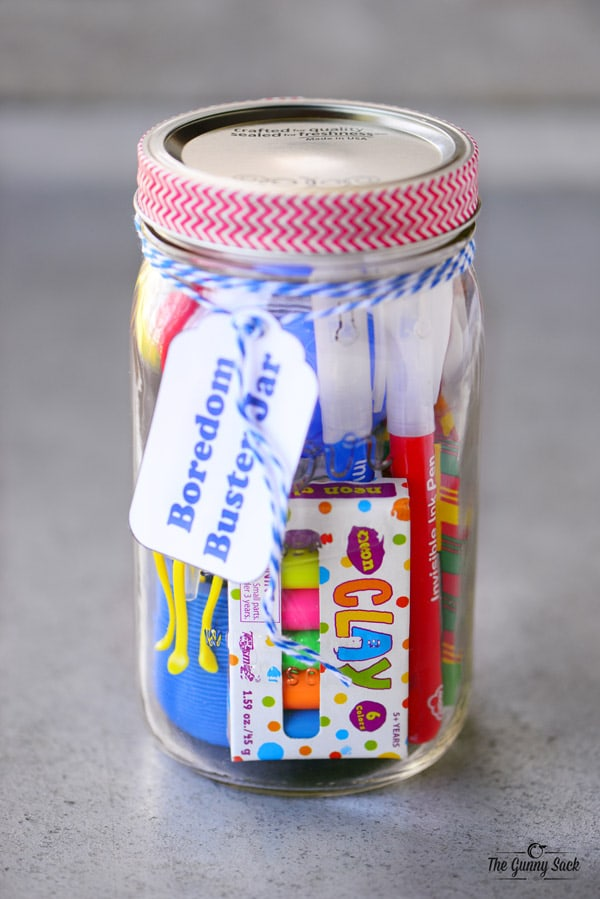 """A """"boredom buster"""" mason jar filled with gift ideas for kids."""