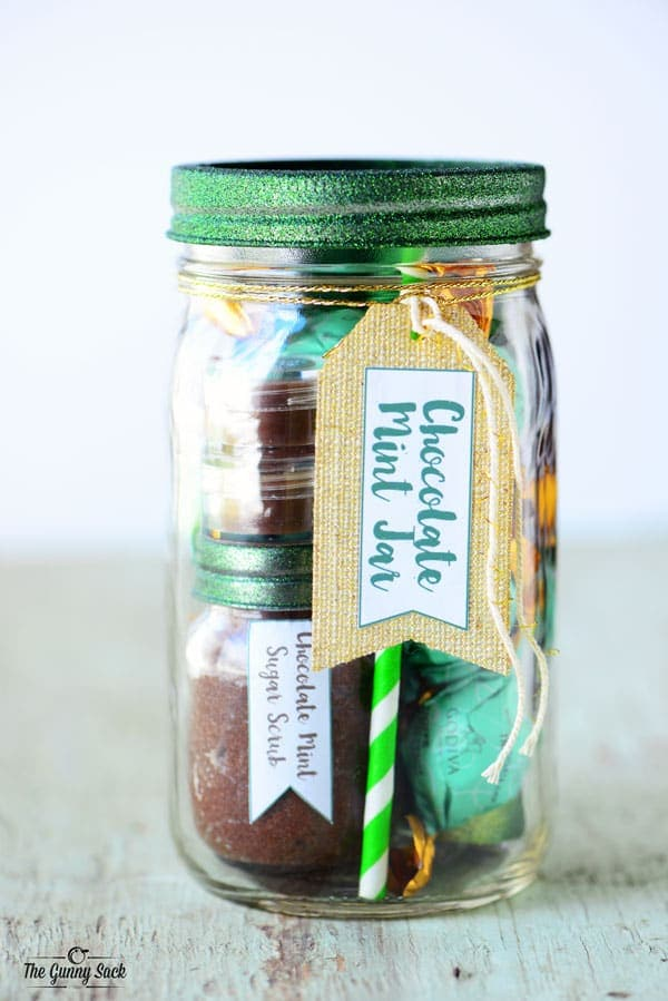 A mason jar filled with chocolate mint candy and spa items.