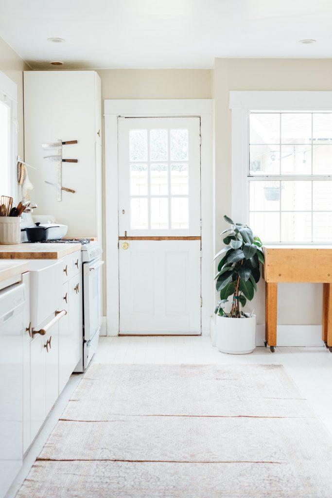 Farmhouse apron sink in a white kitchen.