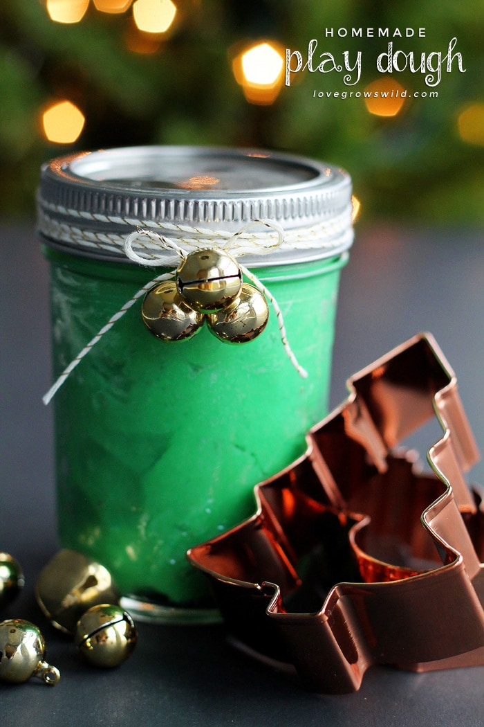 Green homemade playdough packed in a mason jar for a Christmas gift.