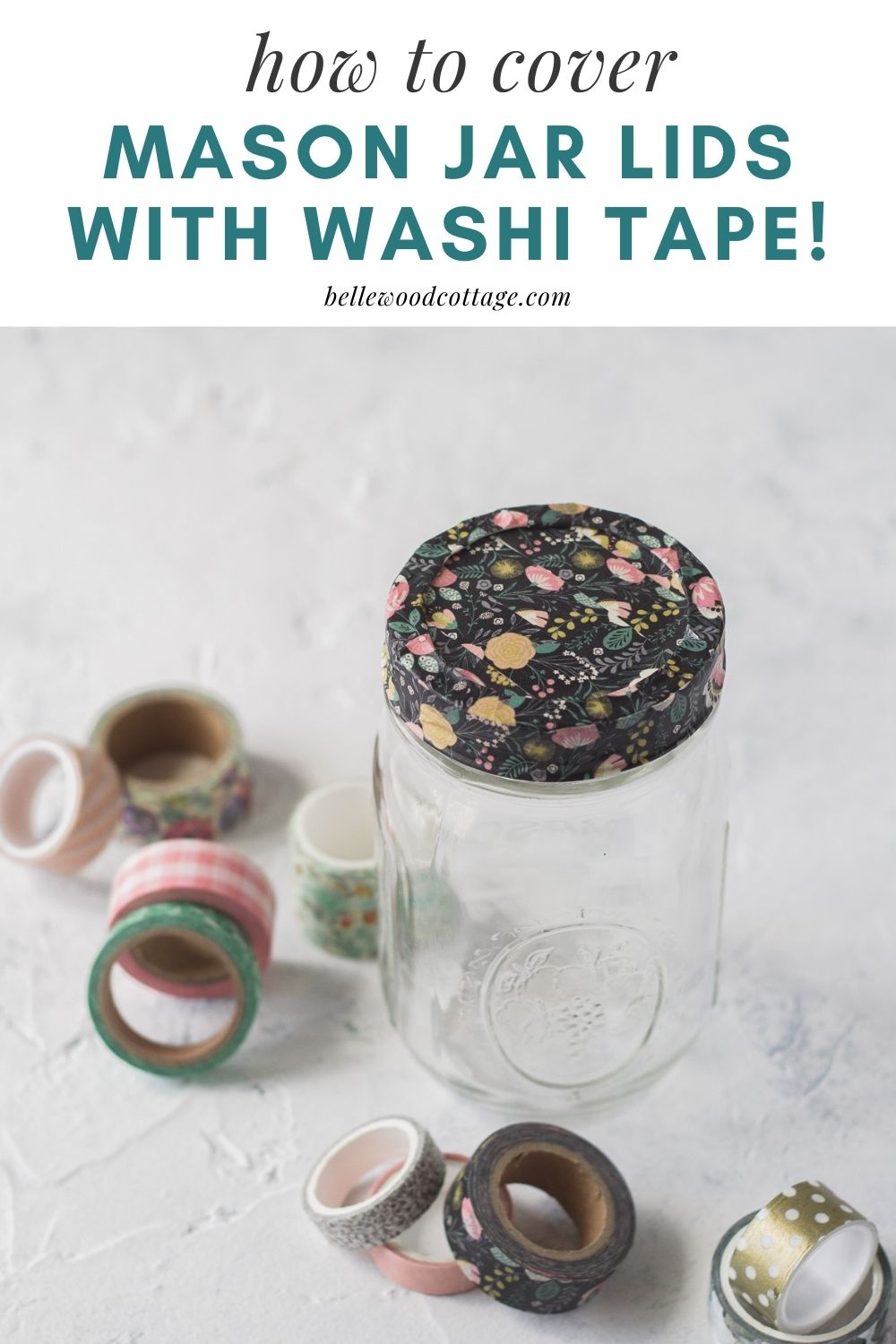 A mason jar with the lid covered in washi tape surrounded by more spools of washi tape.