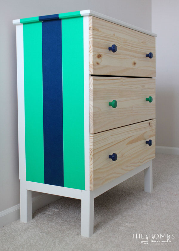 An IKEA dresser decorated with brightly colored washi tape up the side.