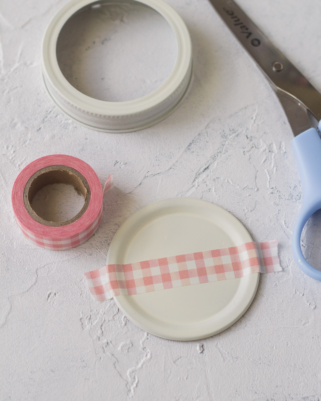 Glass jar lid with washi tape.
