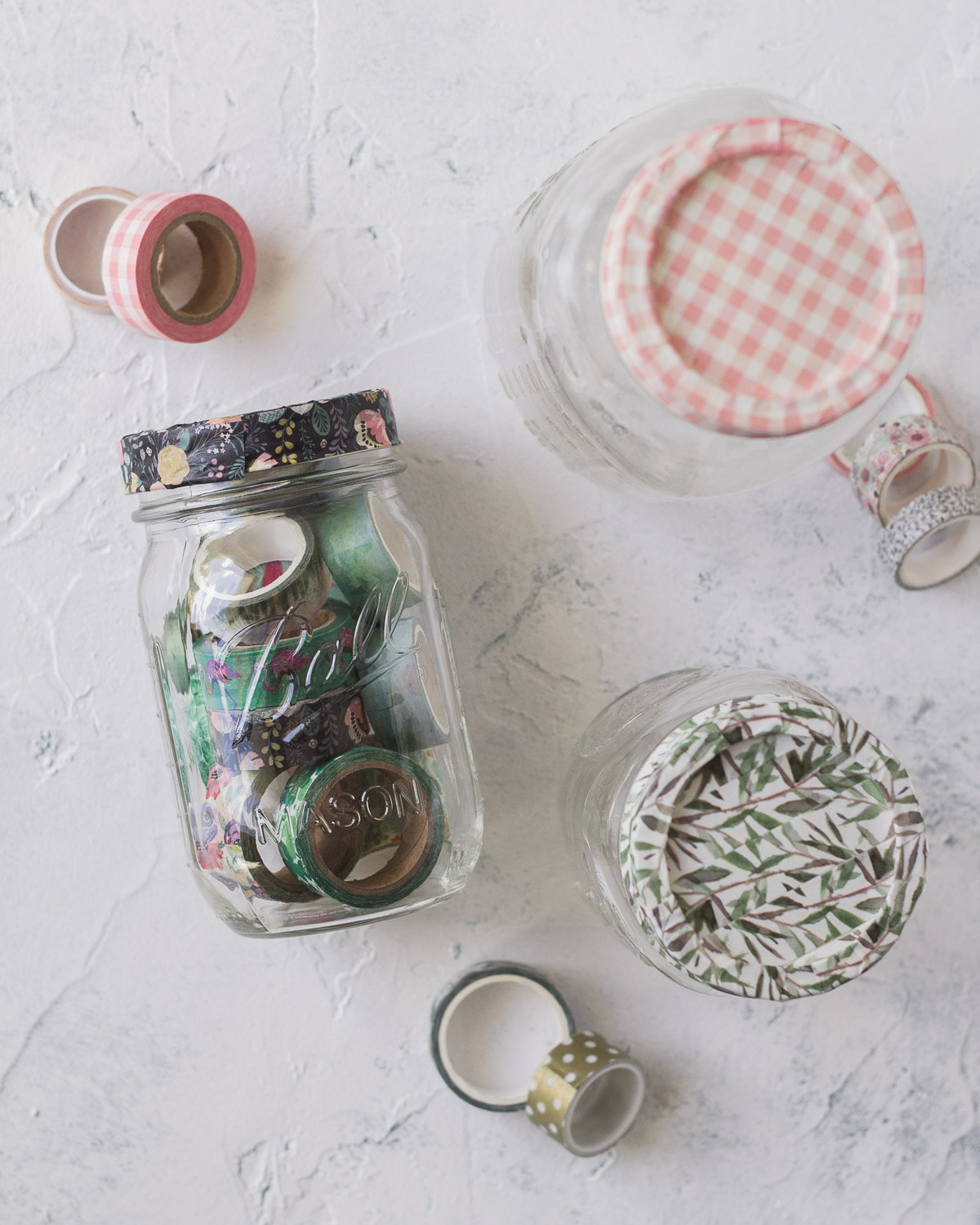 Mason jars filled and covered with washi tape.