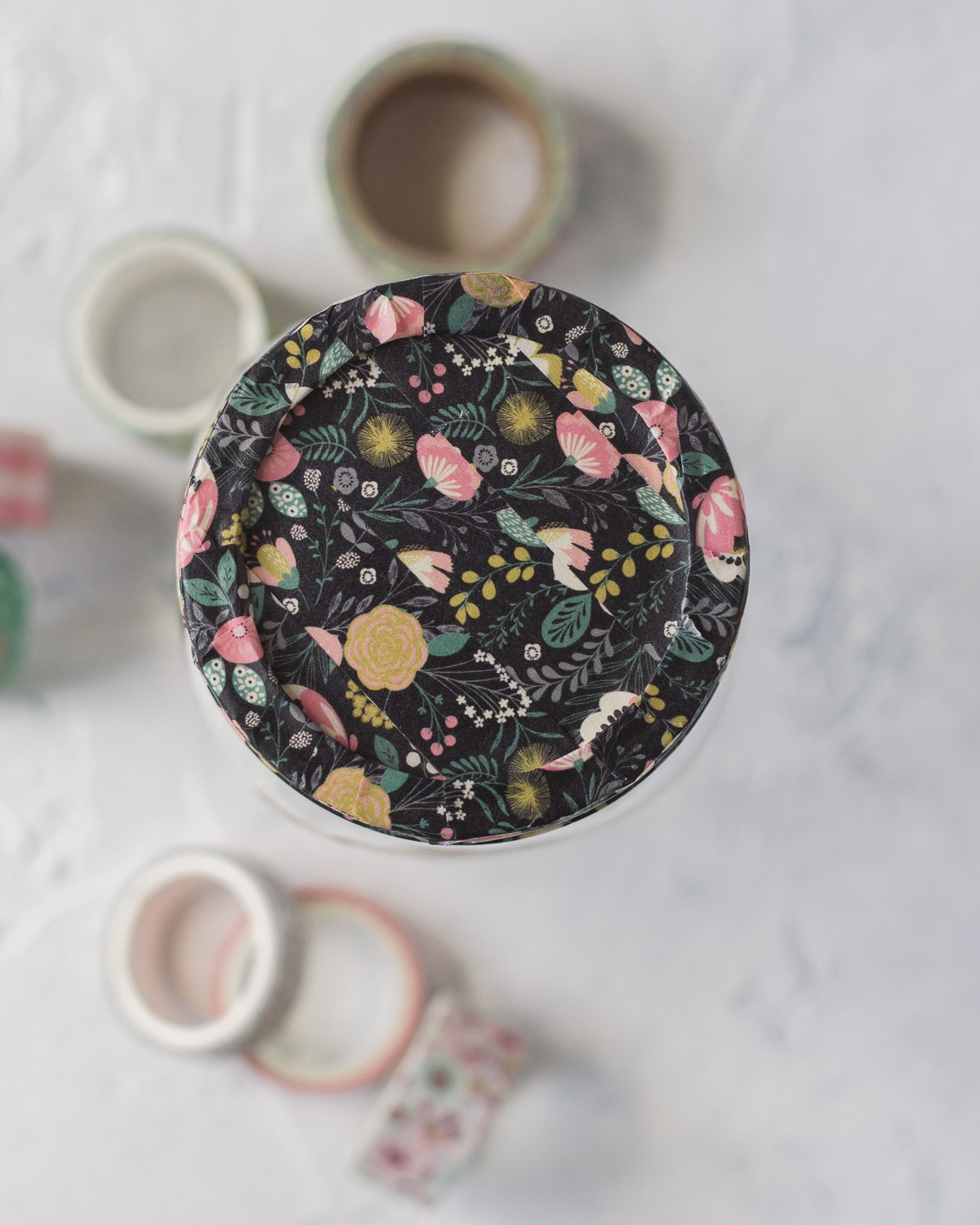 The top of a mason jar covered in washi tape.