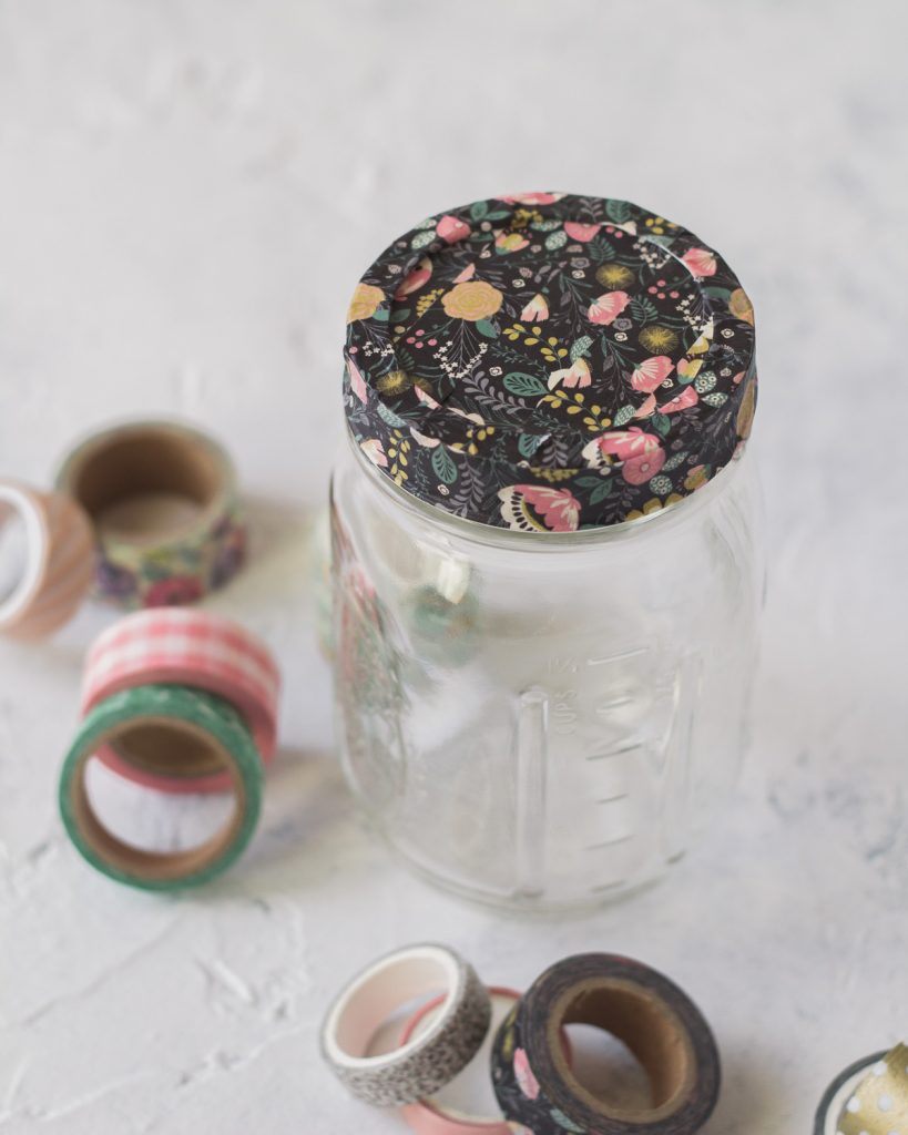 A mason jar with the lid covered in washi tape.