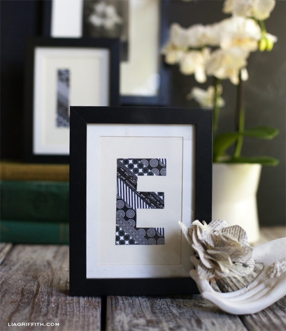 A framed monogram letter made with washi tape.