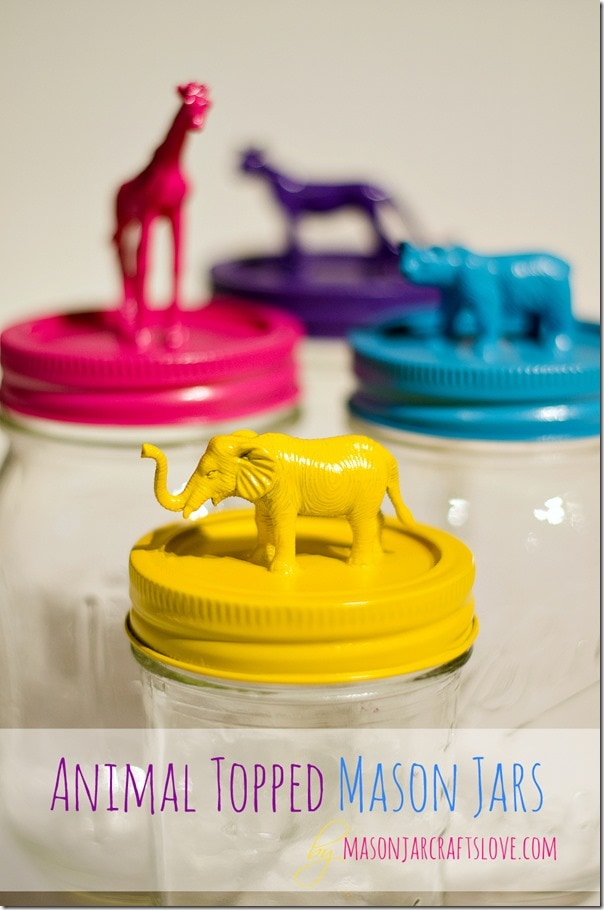 Mason jars topped with plastic animals and spray painted yellow, pink, blue, and purple.