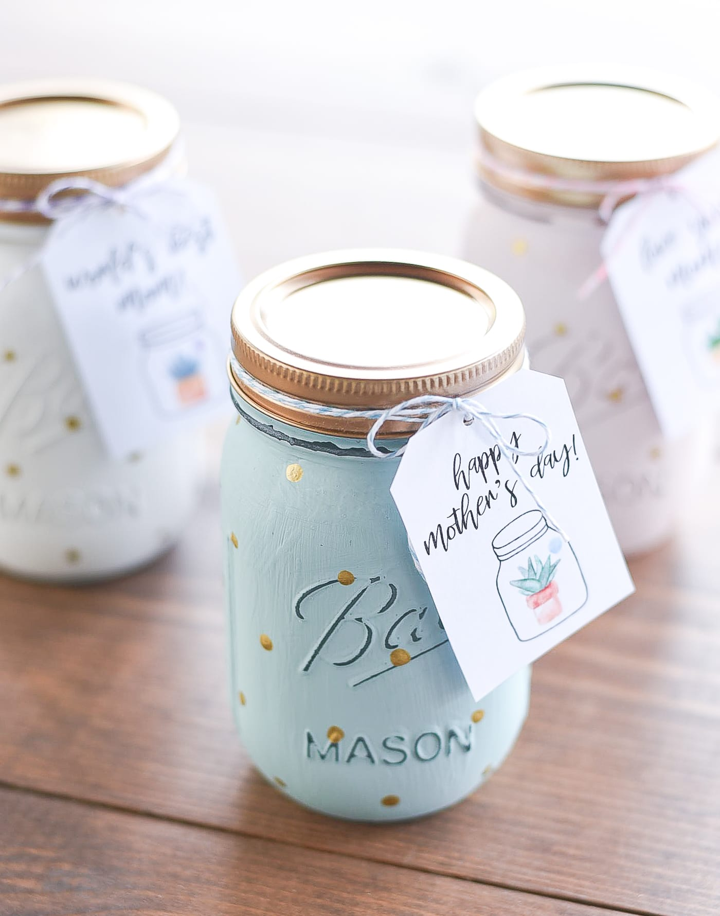 """A painted blue mason jar with a tag that reads, """"Happy Mother's Day!"""""""