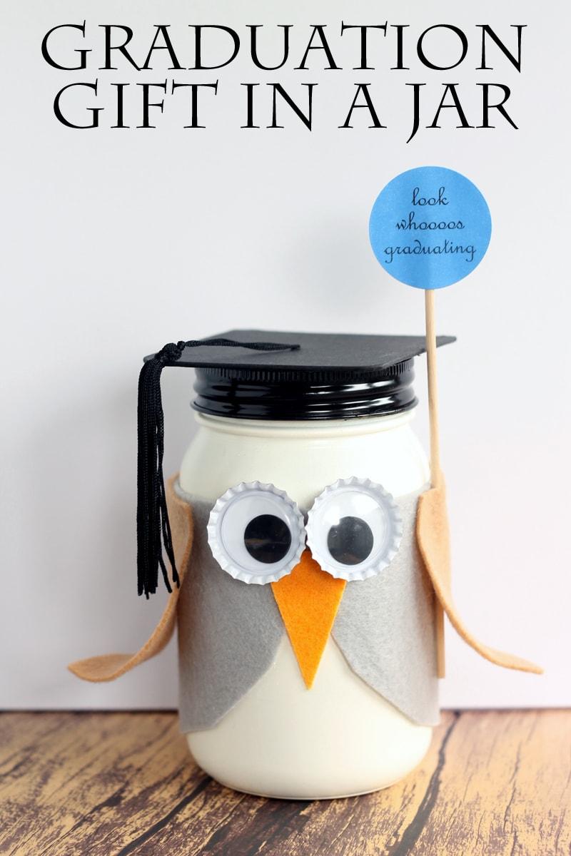 A mason jar decorated as an owl for a graduation gift.
