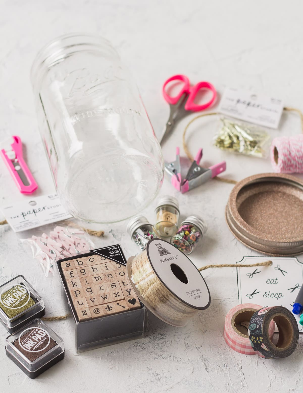 Various craft supplies including twine, rubber stamps and ink, washi tape and more.