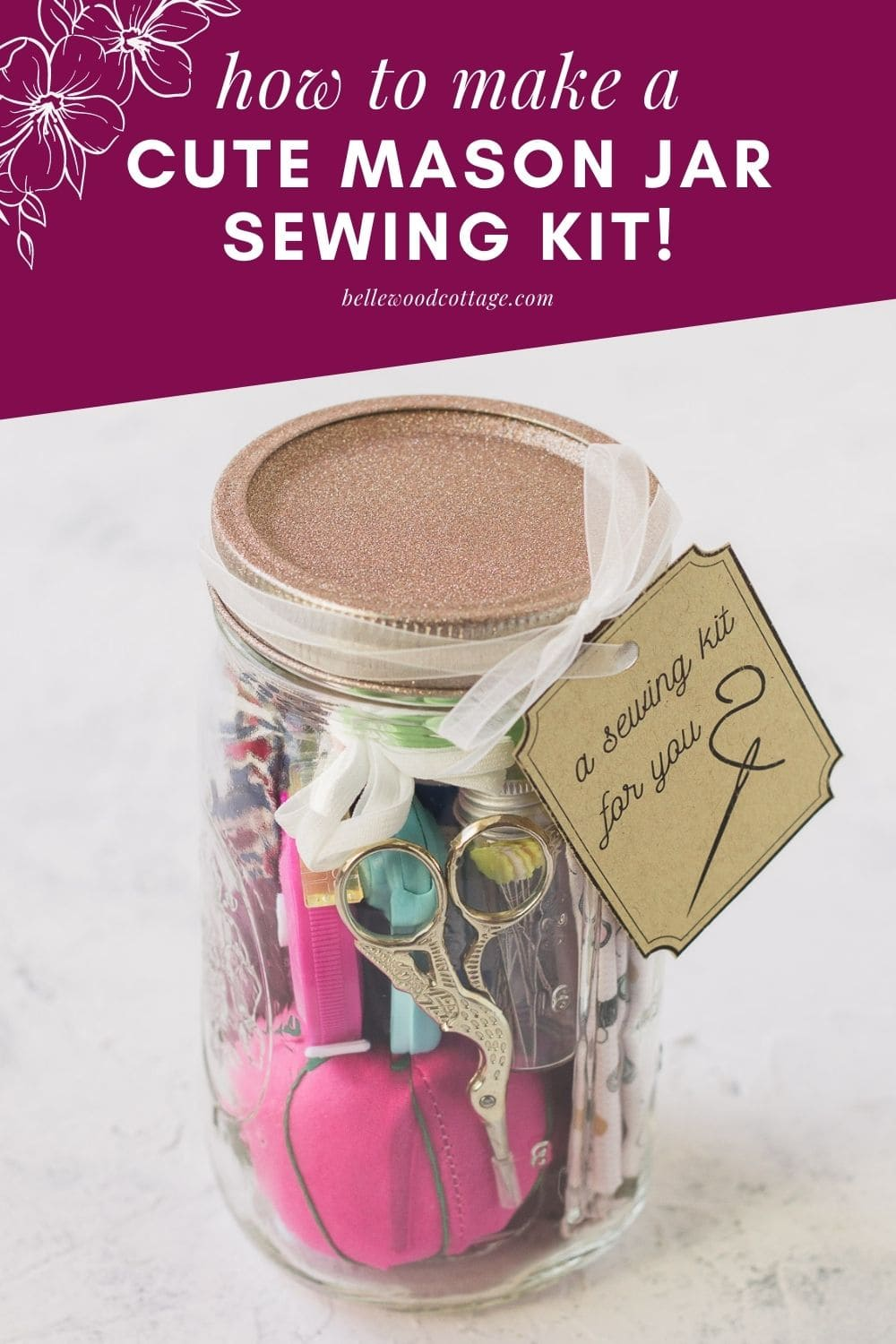 A mason jar sewing kit filled with sewing supplies.