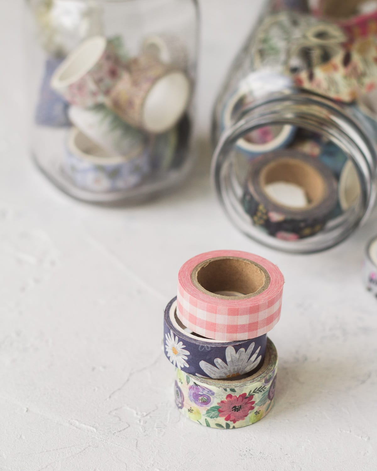 Three washi tape spools in a stack.