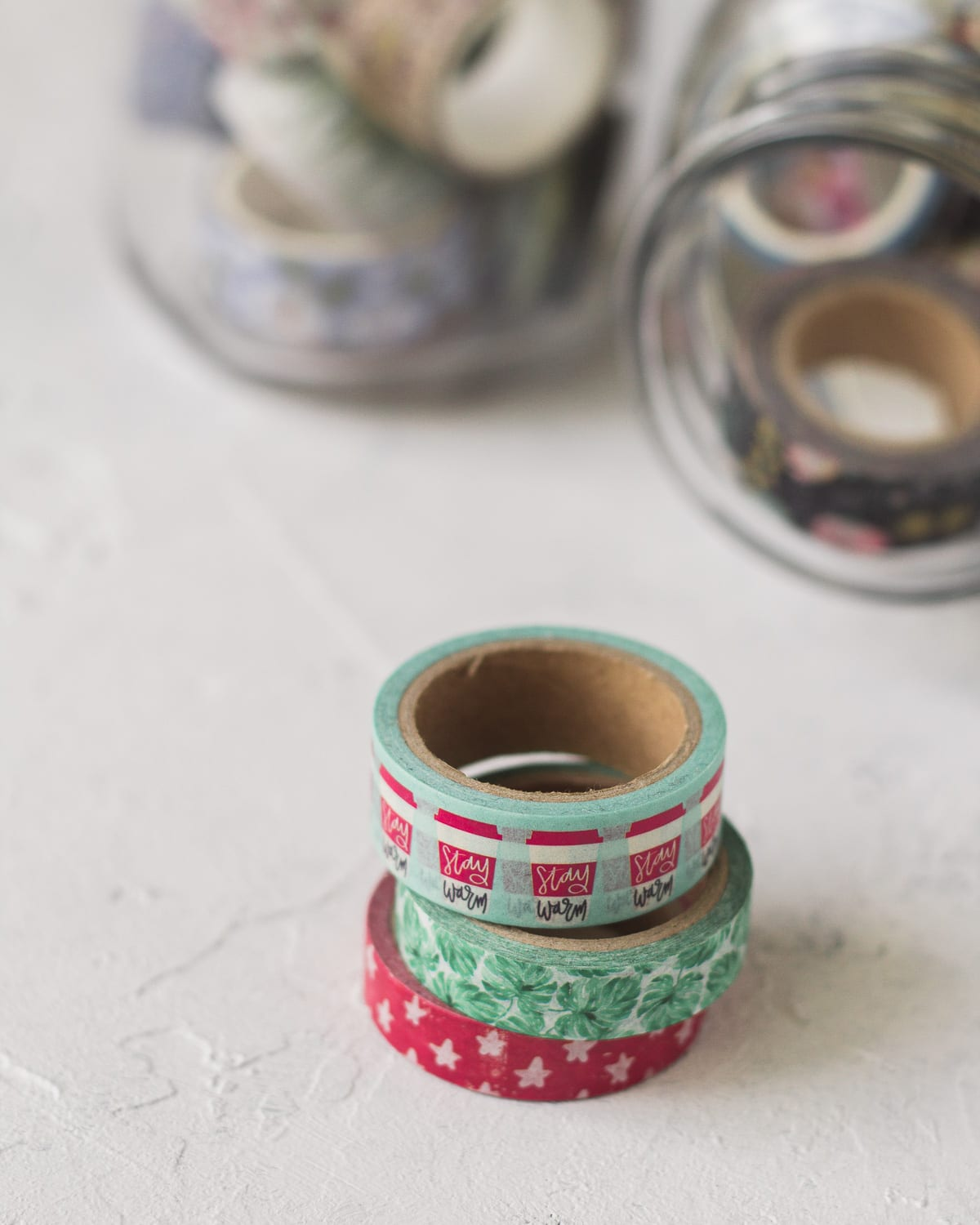 Colorful washi tape spools in a stack.