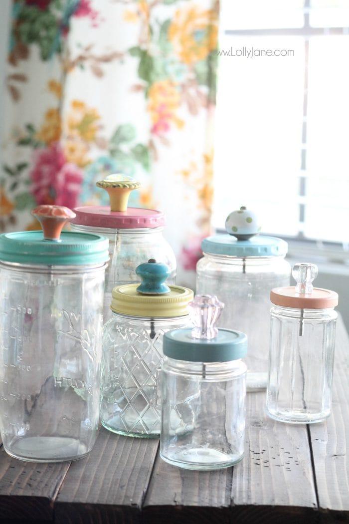 Mason jars upcycled with glass knobs.