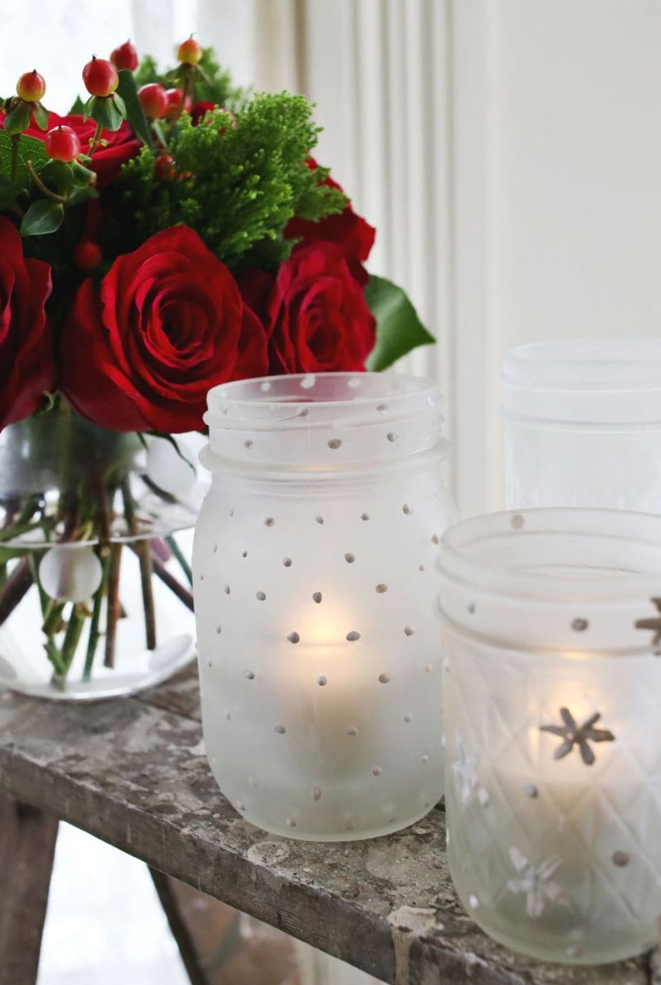 Frosted mason jars with snowflakes.