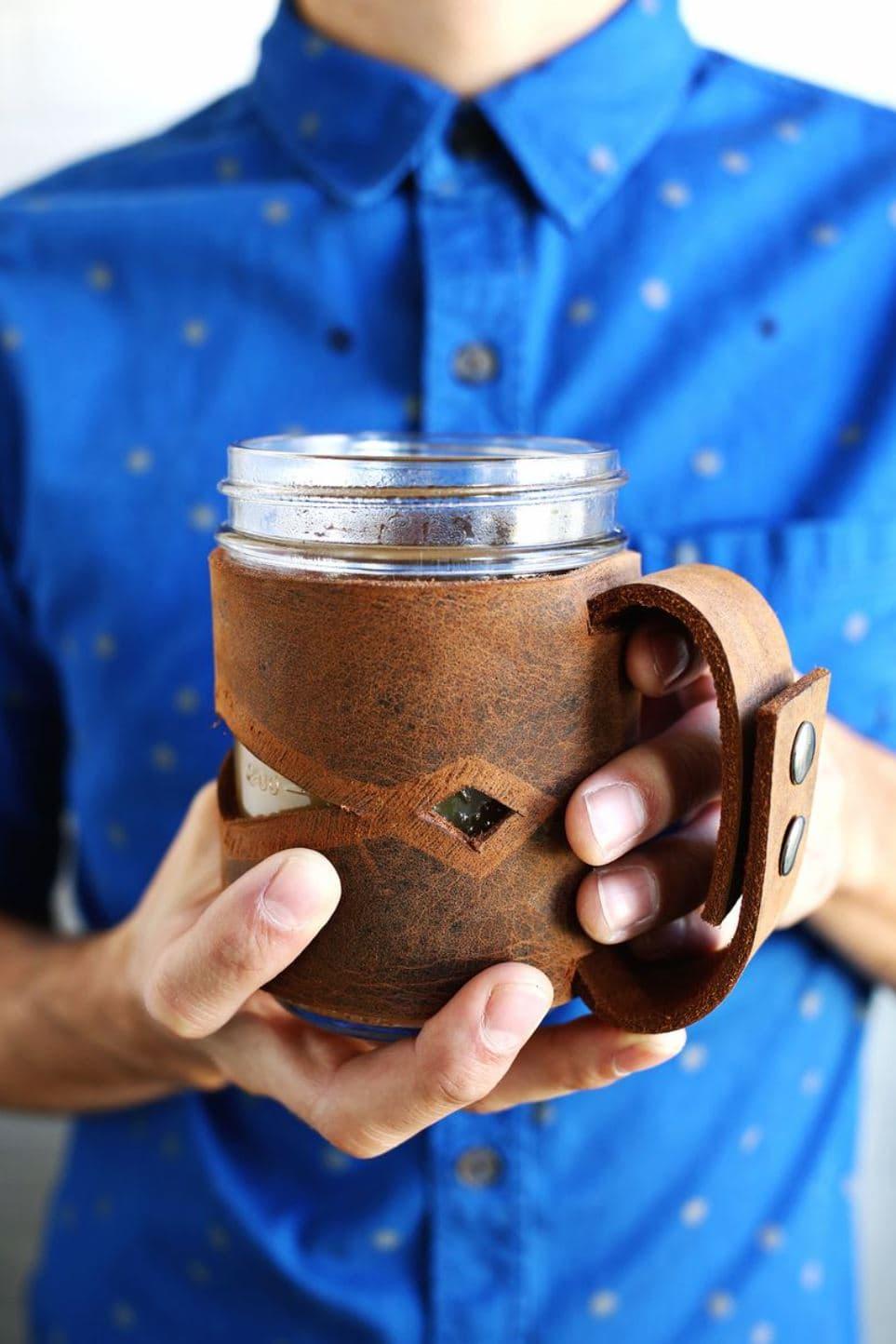 A leather sleeve for a mason jar.