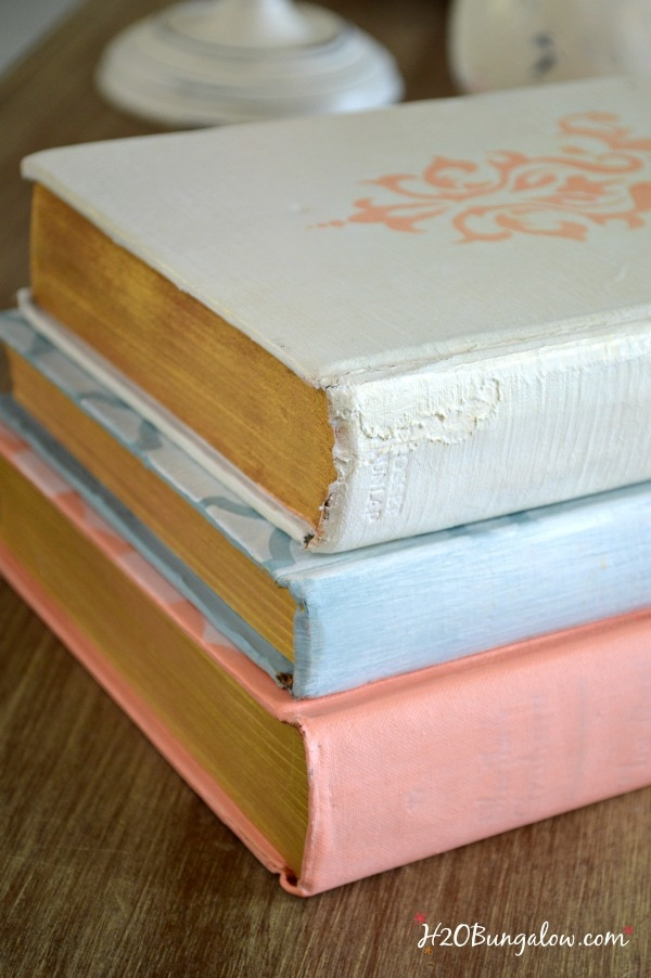Three vintage books painted with chalk paint.