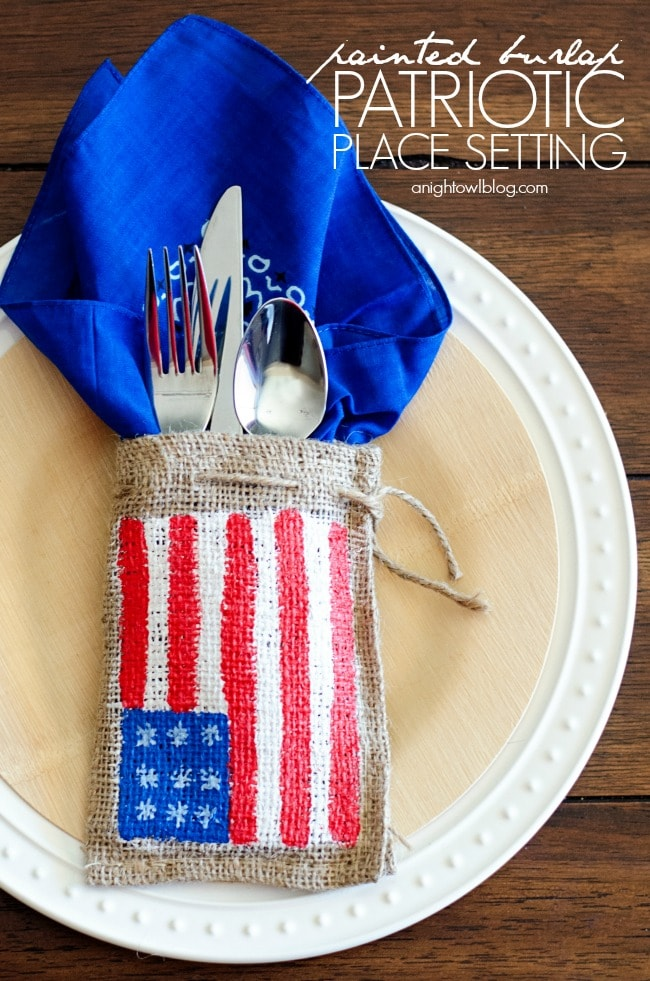 A small burlap bag painted with an American flag and used in a table setting.