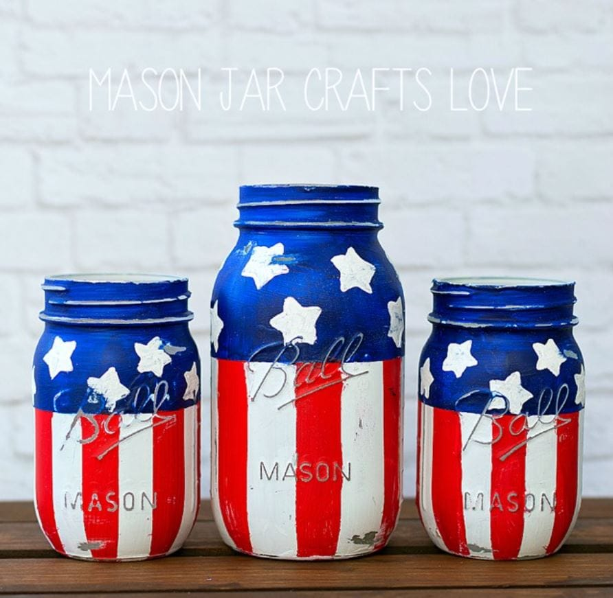 Three mason jars painted in red, white, and blue.