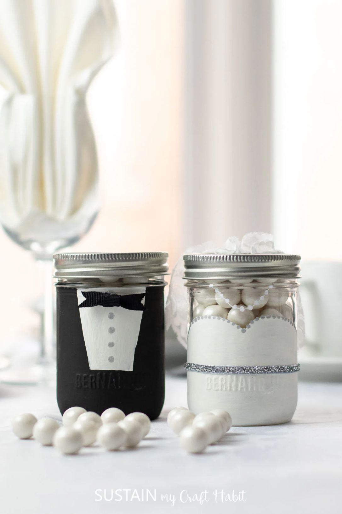 Bride and groom mason jar wedding favors.