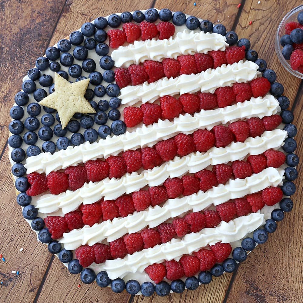 A Round American Flag Fruit Pizza made from sugar cookie dough.