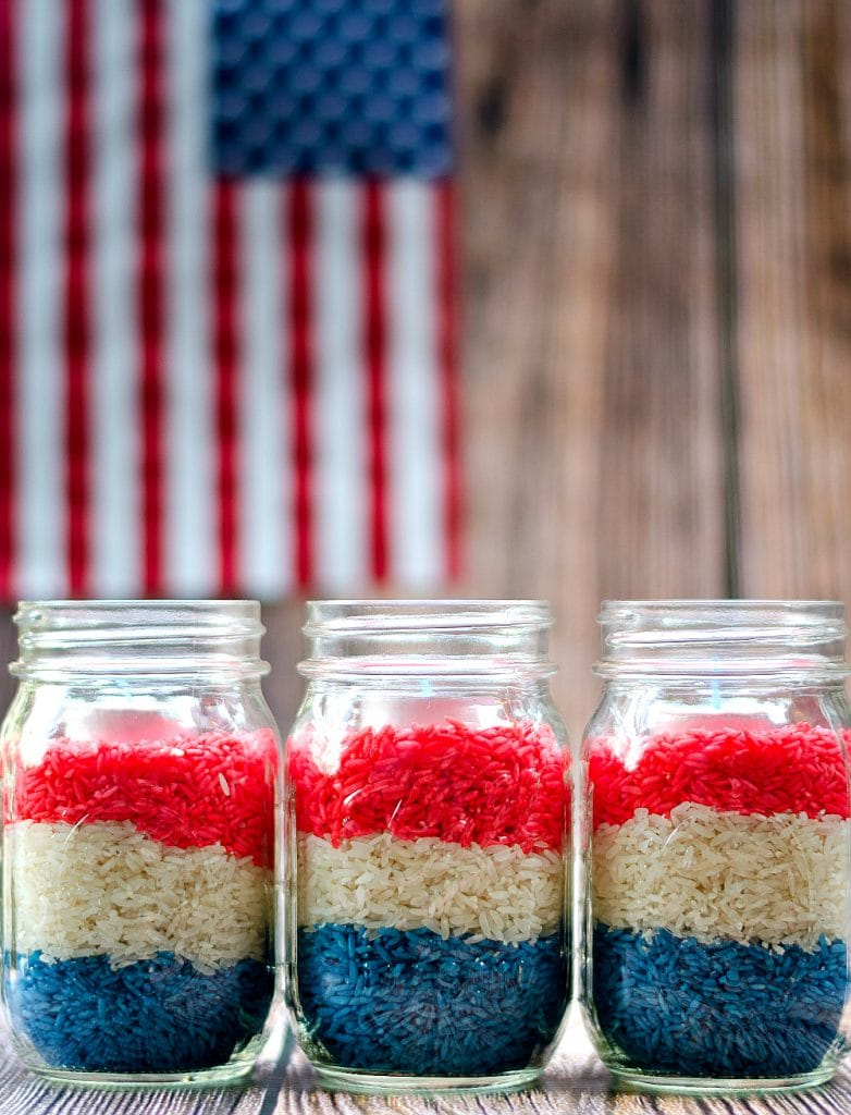 Red, white, and blue rice filling three mason jars.