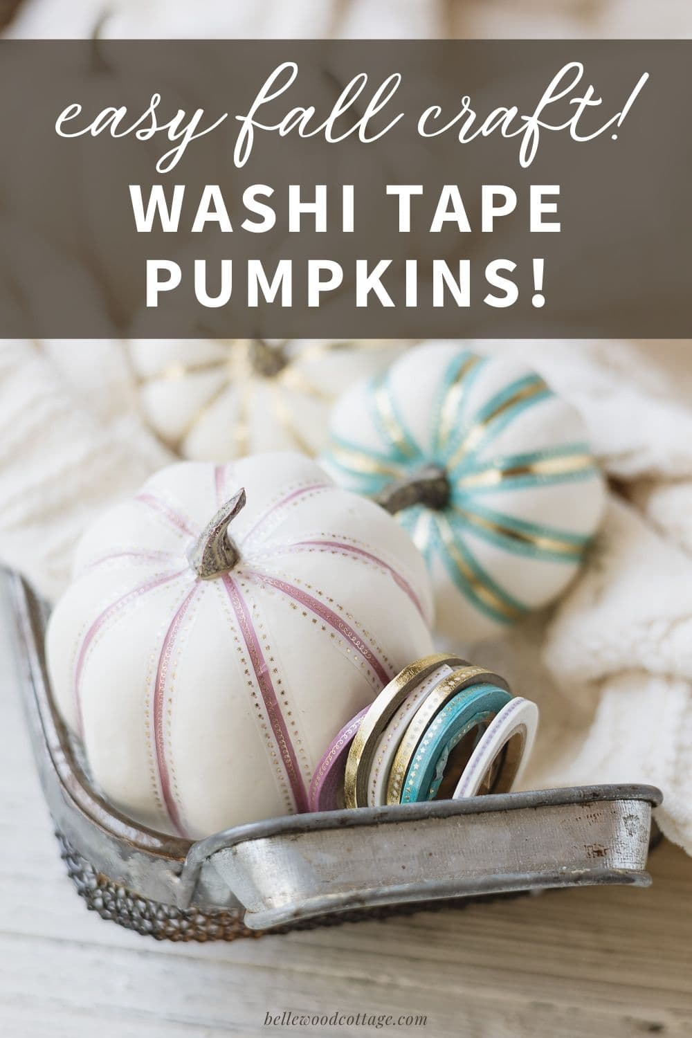 """Washi tape pumpkins in a basket with the words, """"Easy Fall Craft - Washi Tape Pumpkins""""."""