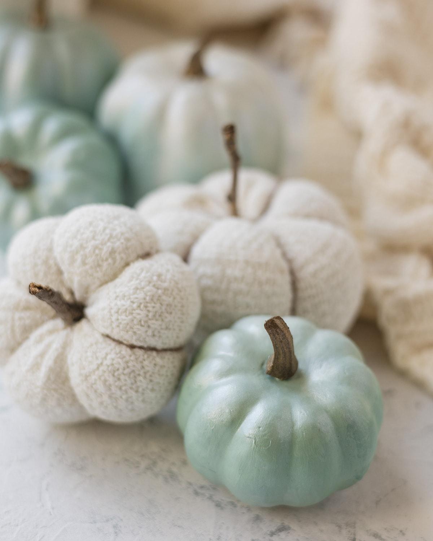 A light blue faux pumpkin and DIY sock pumpkins.