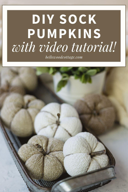 "A basket of handmade sock pumpkins with the words, ""DIY Sock Pumpkins with Video Tutorial!"""